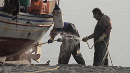 Fishermen who clean their boat of salt deposited after a fishing tour 0a Footage