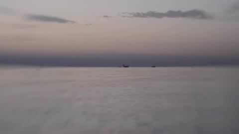 Fishing boats on the high seas among small waves stirred by wind 7 Footage