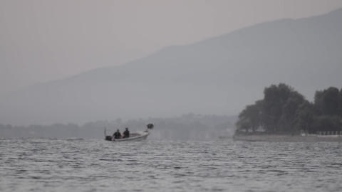 Returning from offshore fishing boats after a fishing expedition at sunset 3a Footage