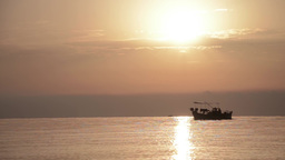 Returning from offshore fishing boats after a fishing expedition at sunset 7 Footage