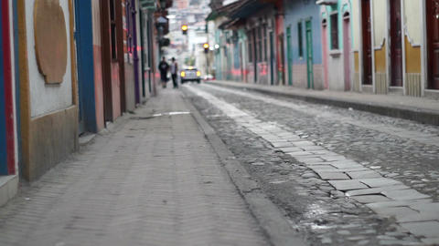 Cobblestone Road with Anonymous People Tilt Up Footage