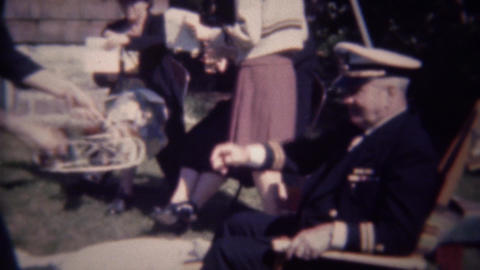 1947: US Navy admiral served afternoon cocktail at outdoor party Live Action