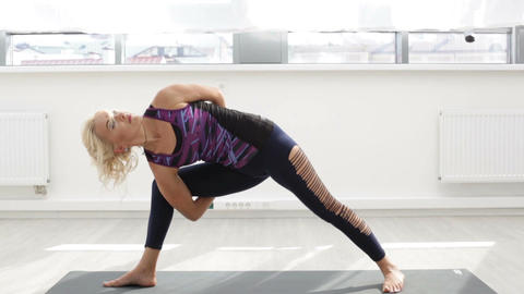 Woman doing yoga exercise Filmmaterial