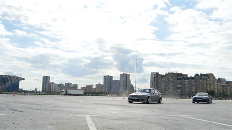 Slow Motion Sports Cars Race and Show Tricks against Buildings Live Action
