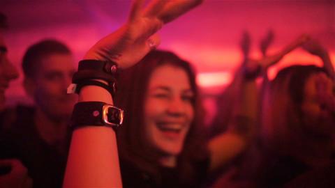 Slow Motion Closeup Girl Dances and Has Fun among People GIF