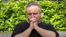 Fat Man Praying Or Thinking Live Action