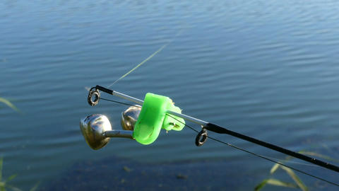 Bell on the end of fishing rod Live Action