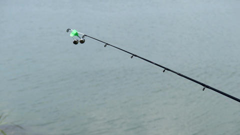 4k - Bell on the end of fishing rod Live Action