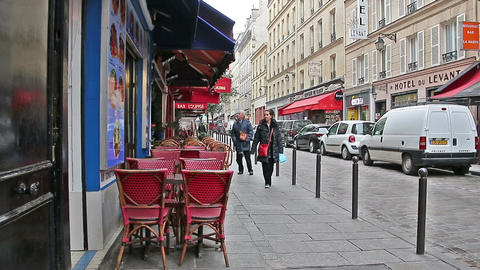 PARIS, FRANCE - March 22, 2016: The streets and cozy cafes of Paris. France Live Action