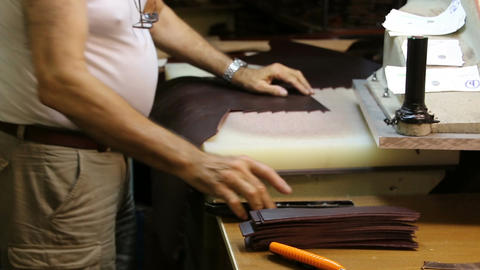 Work shoemaker makes sandals. Shoemaker works with leather on the machine Footage