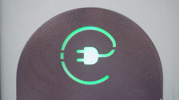 Green sign of power socket for electric cars. Concept of eco friendly resources Footage