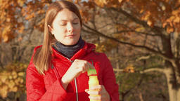 Happy Smiling Woman Enjoying Nature. Standing in autumn park. Female in red coat Footage