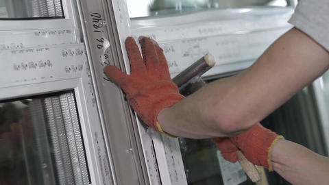 Worker fixes the glazing bead in plastic window Footage