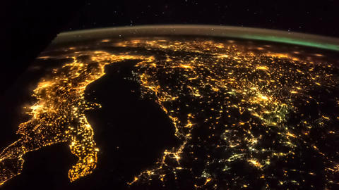 Aerial shot of planet earth in space from ISS at night. Time lapse 4k. Italy Footage
