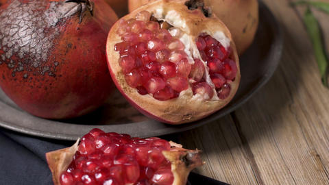 Pomegranate fruit on rustic table Footage