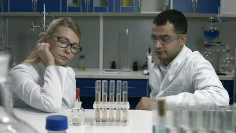 Pensive scientists thinking over bad results Footage