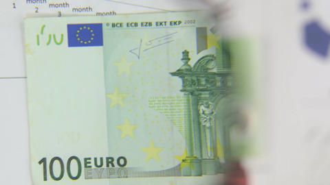 Consider a banknote of one hundred euros, an increase with a magnifying glass. Footage