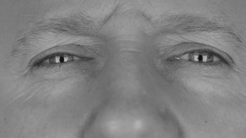 Close-up in black and white on man's eyes, angry eye Live Action