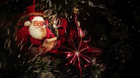 Close up of decorated Christmas tree at night, blurry lights, gold stars Animation