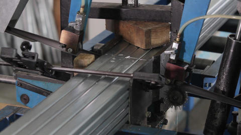 Band saw saws a stack of metal profiles Live Action