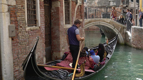 VENICE, ITALY - OCTOBER, 2017: Majestic canals in Venice, Venice, Italy. Gondola Live Action