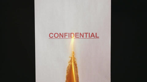 Confidential document. Burning a confidential paper document ビデオ