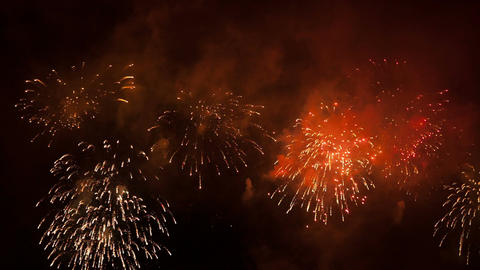 Volleys of celebratory fireworks in the night sky Footage
