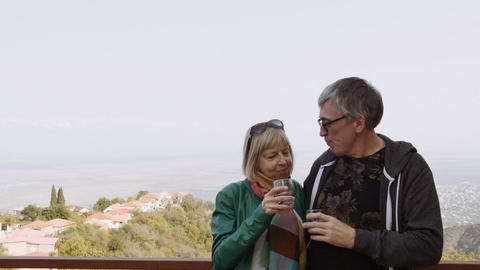 Happy, smiling mature couple drinking wine outdoors.... Stock Video Footage