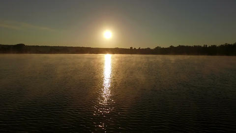 Beautiful sunset over lake - aerial shot Footage