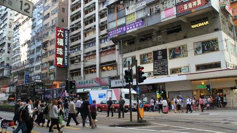 Busy city people on zebra crossing in Hong Kong Footage
