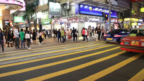 People and traffic on busy street at night Footage