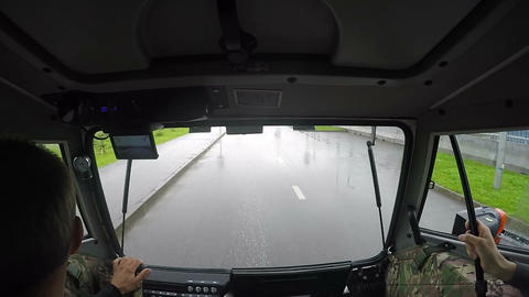 Slow Motion Man Drives Vehicle along Asphalt Road on Rainy Day Footage