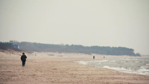 Person recreation nordic walking on the beach in Palanga, Lithuania 画像