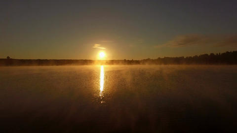 Fantastic aerial shot in 4k of fog over lake at sunset Footage