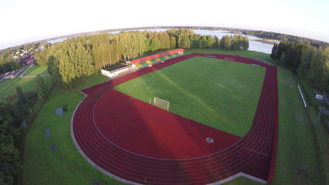 Drone fly up over sport stadium in morning sunlight Filmmaterial
