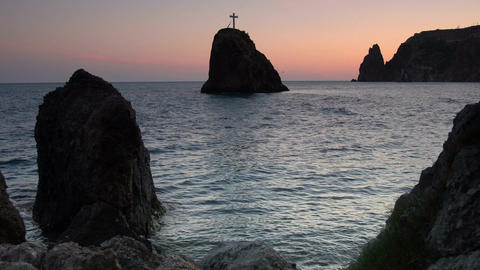 Rock of the holy phenomenon. Cross on a rock in the sea, on the coast in the Footage