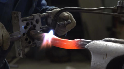 Metal processing in the forge. The heating and shaping Footage
