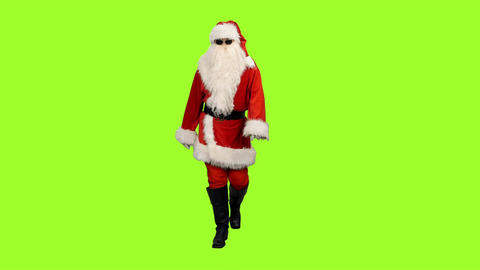 Santa Claus in sunglasses walking on green screen background, Chroma key Footage