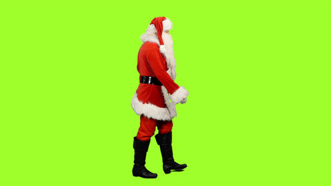 Side view of walking Santa Claus on green background, Chroma key Footage