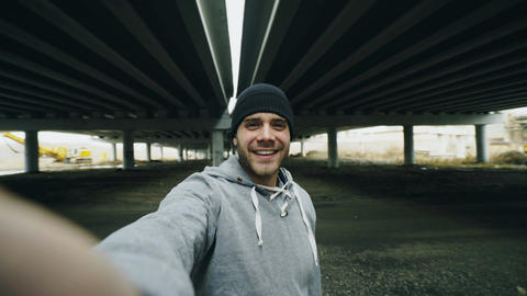 POV of Happy sportive man taking selfie portrait with smartphone after training Live Action