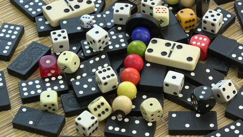 Rotating game bones, domino, black and white dices and child toys Footage