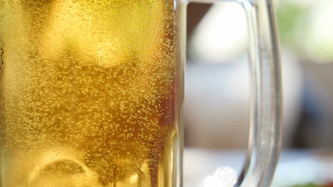 Full glass of beer bubbles close-up Footage