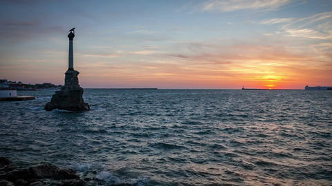 Sea at sunset and a monument (Monument to the Scuttled Ships) in the sea Live Action