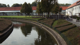 Canal running through grounds of an housing complex HD stock footage Footage