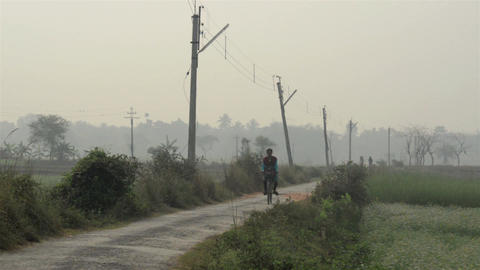 An Indian village girl approaching towards camera in smog at the morning Live Action