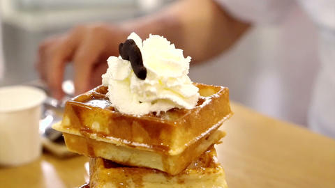 Video of waffle syrup and ice cream with whip cream topping, delicious sweet Footage