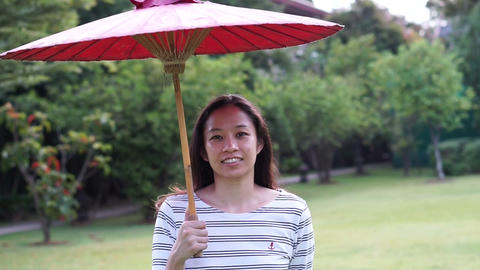 oriental red umbrella with asian girl Live Action