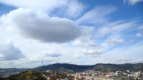 Cumulus clouds gather to gray rainy cloudscape over Barcelona, then cleared away Footage