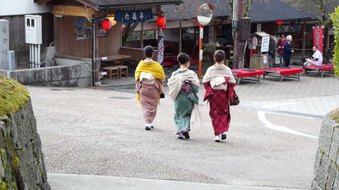 Kyoto, Japan -March 2015: Japanese girls wear kimono parasol and geta Japan Footage