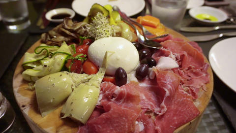Italian antipasto dried ham, cheese and grilled vegetable Footage